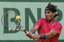 Spain's Rafael Nadal returns the ball to compatriot David Ferrer during their semifinal match in the French Open tennis tournament at the Roland Garros stadium in Paris, Friday, June 8, 2012. (AP Photo/Michel Euler)