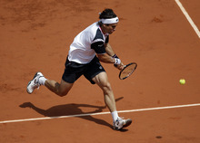 Spain's David Ferrer returns the ball to compatriot Rafael Nadal during their semifinal match in the French Open tennis tournament at the Roland Garros stadium in Paris, Friday, June 8, 2012. (AP Photo/Christophe Ena)
