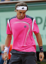 Spain's David Ferrer reacts as he plays  compatriot Rafael Nadal during their semifinal match in the French Open tennis tournament at the Roland Garros stadium in Paris, Friday, June 8, 2012. (AP Photo/Michel Euler)