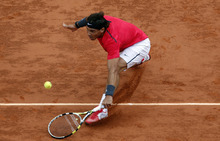 Spain's Rafael Nadal returns the ball to compatriot David Ferrer during their semifinal match in the French Open tennis tournament at the Roland Garros stadium in Paris, Friday, June 8, 2012. (AP Photo/Christophe Ena)