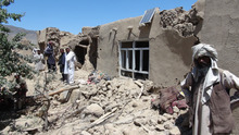 Afghan villagers gather near a house destroyed in an apparent NATO raid in Logar province, south of Kabul, Afghanistan on Wednesday, June, 6, 2012. Afghan officials and residents say a pre-dawn NATO airstrike aimed at militants in eastern Afghanistan killed civilians celebrating a wedding, including women and children. (AP Photo/Ihsanullah Majroh)