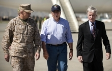 US Defense Secretary Leon Panetta, center, walks with U.S. Ambassador to Afghanistan Ryan Crocker, right, and head of NATO coalition forces in Afghanistan Gen. John Allen, left, upon his arrival at the Kabul International Airport in Afghanistan, Thursday, June 7, 2012. Panetta arrived in Afghanistan on Thursday to take stock of progress in the war and discuss plans for the troop drawdown, even as violence spiked in the south. (AP Photo/Jim Watson, Pool)