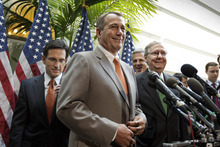 House Speaker John Boehner of Ohio, center, accompanied by fellow GOP leaders, arrives for a news conference on Capitol Hill in Washington, Wednesday, June 6, 2012. From left are, House Majority Leader Eric Cantor of Va., Boehner,  House Majority Whip Kevin McCarthy of Calif., and Senate Minority Leader Mitch McConnell of Ky. (AP Photo/J. Scott Applewhite)  Kevin McCarthy