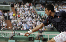 Serbia's Novak Djokovic returns the ball to Switzerland's Roger Federer during their semifinal match in the French Open tennis tournament at the Roland Garros stadium in Paris, Friday, June 8, 2012.   (AP Photo/Michel Spingler)