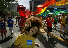 Scott Sommerdorf  |  The Salt Lake Tribune              The American Express entry at the annual Gay Pride Parade through downtown Salt Lake City, Sunday, June 3, 2012.