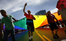 Scott Sommerdorf  |  The Salt Lake Tribune              The Gay Pride rainbow flag marks the end of the annual Gay Pride Parade through downtown Salt Lake City, Sunday, June 3, 2012.