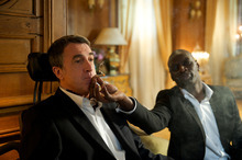 Thierry Valletoux  |  The Weinstein Company Philippe (Francois Cluzet, left) is a quadriplegic who forms a friendship with his caretaker, Driss (Omar Sy), in the French comedy-drama