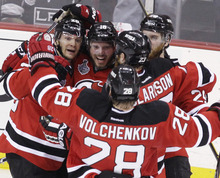 New Jersey Devils' Patrik Elias, left, of the Czech Republic, celebrates with teammates after scoring a goal against the Los Angeles Kings during the second period of Game 1 of the NHL hockey Stanley Cup finals Wednesday, May 30, 2012, in Newark, N.J. (AP Photo/Frank Franklin II)