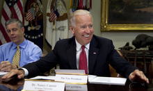 Vice President Joe Biden, accompanied by Education Secretary Arne Duncan, left, speaks during a roundtable with college presidents and education system leaders, Tuesday, June 5, 2012, in the Roosevelt Room of the White House in Washington. (AP Photo/Carolyn Kaster)