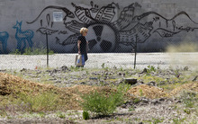Al Hartmann  |  The Salt Lake Tribune  A pedestrian walks past the empty lot that has been locally named the