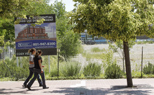 Al Hartmann  |  The Salt Lake Tribune  A pedestrian walks along 2100 South and Highland Drive past the so-called