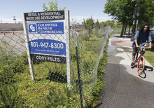 Al Hartmann  |  The Salt Lake Tribune  When it is completed, the planned Sugar House Crossing development is expected to change the face of the community -- a stark contrast from the empty lot that has proved an eyesore for the past three years. A bicyclist rides along Highland Drive near the so-called