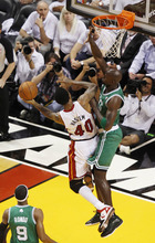 Miami Heat's Udonis Haslem (40) drives to the basket as Boston Celtics' Ray Allen defends during the first half of Game 5 in their NBA basketball Eastern Conference finals playoffs series, Tuesday, June 5, 2012, in Miami. (AP Photo/Wilfredo Lee)