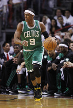 Boston Celtics' Rajon Rondo (9) dribbles the ball during the first half of Game 5 in their NBA basketball Eastern Conference finals playoffs seriesagainst the Miami Heat, Tuesday, June 5, 2012, in Miami. (AP Photo/Lynne Sladky)