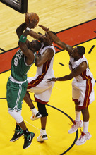 Boston Celtics' Mickael Pietrus (28) drives to the basket as Miami Heat's Chris Bosh and Dwyane Wade defend during the first half of Game 5 in their NBA basketball Eastern Conference finals playoffs series, Tuesday, June 5, 2012, in Miami. (AP Photo/Wilfredo Lee)