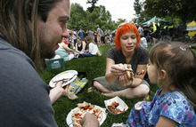 Scott Sommerdorf  |  The Salt Lake Tribune              Bryan, Michelle and young Morgan Ashby eat lunch on the grass at the opening Saturday of the Salt Lake Farmers Market, Saturday, June 9, 2012.