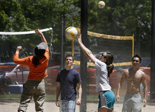 Scott Sommerdorf  |  The Salt Lake Tribune              Multiple teams played volleyball on the new beach volleyball courts in Liberty Park in Salt Lake City, Sunday, June 10, 2012.