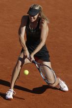 Maria Sharapova of Russia returns in her semi final match against Petra Kvitova of the Czech Republic at the French Open tennis tournament in Roland Garros stadium in Paris, Thursday June 7, 2012. (AP Photo/Michel Spingler)