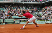 Spain's Rafael Nadal returns the ball to Serbia's Novak Djokovic during their men's final match in the French Open tennis tournament at the Roland Garros stadium in Paris, Sunday, June 10, 2012.   (AP Photo/Christophe Ena)