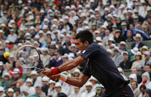 Serbia's Novak Djokovic returns the ball to Spain's Rafael Nadal during their men's final match in the French Open tennis tournament at the Roland Garros stadium in Paris, Sunday, June 10, 2012.   (AP Photo/Christophe Ena)