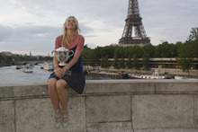 Maria Sharapova of Russia poses with the trophy after winning the women's final match against Sara Errani of Italy at the French Open tennis tournament in Paris, Saturday June 9, 2012. Eiffel Tower and Seine river in the background. (AP Photo/Michel Euler)