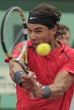 Rafael Nadal of Spain returns in the mens final match against Novak Djokovic of Serbia at the French Open tennis tournament in Roland Garros stadium in Paris, Sunday June 10, 2012. (AP Photo/Bernat Armangue)