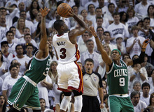 Miami Heat's Dwyane Wade (3) drives to the basket as Boston Celtics' Rajon Rondo (9) and Paul Pierce (34) defend during the second half of Game 7 of the NBA basketball playoffs Eastern Conference finals, Saturday, June 9, 2012, in Miami. The Heat defeated the Celtics 101-88. (AP Photo/Lynne Sladky)