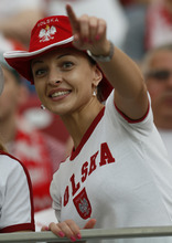 A Polish soccer fan gestures as she waits for the start of the Euro 2012 soccer championship Group A match between Poland and Greece in Warsaw, Poland, Friday, June 8, 2012. (AP Photo/Michael Sohn)