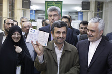 FILE - In this March 2, 2012 file photo, Iranian President Mahmoud Ahmadinejad shows his identification document after casting his ballot for the parliamentary elections at a polling station, while Vice-President Mohammad Reza Rahimi, right, looks on in downtown Tehran, Iran. Despite the heavy attention on Iran's external struggles, including sanctions and the shaky rule of critical ally Bashar Assad in Syria, the coming year could be a highly inward-looking one for Iran, and Ahmadinejad will be looking ahead for ways to secure some kind of post-presidency political role. (AP Photo/Vahid Salemi, File)