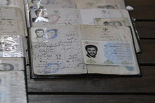 FILE - In this March 2, 2012 file photo, the Identification document of Iranian President Mahmoud Ahmadinejad is placed on a polling station table during the parliamentary elections in downtown Tehran, Iran. Ahmadinejad, the one-time favored son of Iran's theocracy is now limping into his last year in office sharply weakened and in the unexpected position as an outcast among hard-liners. (AP Photo/Vahid Salemi, File)