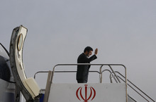 FILE - In this Dec. 17, 2009 file photo, Iranian President Mahmoud Ahmadinejad waves before boarding his plane leaving Tehran's Mehrabad airport for Copenhagen to attend the U.N. Climate Summit. The one-time favored son of Iran's theocracy is now limping into his last year in office sharply weakened and in the unexpected position as an outcast among hard-liners. (AP Photo/Vahid Salemi, File)