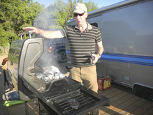 Tom Wharton  |  The Salt Lake Tribune Steve Lewis of Salt Lake City grills up dinner on the deck of an Airstream trailer at the Shooting Star Drive-in near Escalante.