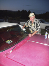Tom Wharton  |  The Salt Lake Tribune Shooting Star Drive-In owner Mark Gudenas wipes off a windshield of one of the classic convertibles patrons can sit in to watch classic movies.