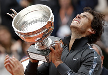 Spain's Rafael Nadal holds the cup after defeating Serbia's Novak Djokovic in their men's final match in the French Open tennis tournament at the Roland Garros stadium in Paris, Monday, June 11, 2012. Nadal pass Bjorn Borg as the all-time record-holder for French Open titles. (AP Photo/Bernat Armangue)