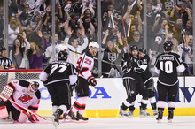Los Angeles Kings center Trevor Lewis (22) and Los Angeles Kings left wing Dwight King (74) celebrate after Lewis' goal against the New Jersey Devils in the first period during Game 6 of the NHL hockey Stanley Cup finals,Monday, June 11, 2012, in Los Angeles.  (AP Photo/Mark J. Terrill)