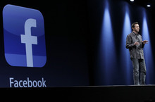 Apple's Scott Forstall talks about using Facebook at the Apple Developers Conference in San Francisco, Monday, June 11, 2012. Fresh off a disappointing initial public offering, Facebook got a big boost from Apple, which is building the social network deep into its iPhone and iPad software. (AP Photo/Paul Sakuma)