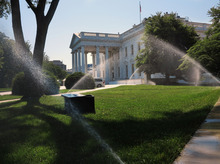 Sprinklers water the White House lawn in Washington, Sunday, June 10, 2012. (AP Photo/Jacquelyn Martin)