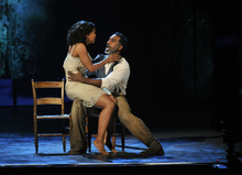 Audra McDonald, left, and Norm Lewis perform in a scene from
