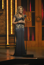 Sheryl Crow presents an award at the 66th Annual Tony Awards on Sunday June 10, 2012, in New York. (Photo by Charles Sykes /Invision/AP)