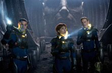 This film image released by 20th Century Fox shows Logan Marshall-Green, left, Noomi Rapace, and Michael Fassbender, right, in a scene from