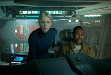This film image released by 20th Century Fox shows Charlize Theron, left, and Idris Elba in a scene from
