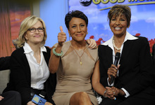 This image released by ABC shows host Robin Roberts, center, with her sister Sally-Ann Roberts, right and ABC News' Diane Sawyer on