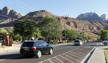 Al Hartmann  |  The Salt Lake Tribune  Cars drive on Zion Park Blvd. in Springdale to enter Zion National Park Monday June 11.   A Utah state audit says that Springdale police were illegally collecting money from foreign tourists and some of the cash is missing.