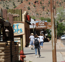 Al Hartmann  |  The Salt Lake Tribune  Tourists walk past shops along Zion Park Blvd, on Springdale Monday June 11.  A Utah state audit says that Springdale police were illegally collecting money from foreign tourists and some of the cash is missing.