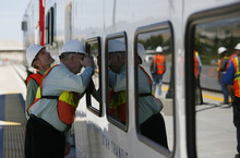 Francisco Kjolseth  |  The Salt Lake Tribune Lehi City Administrator Derek Todd, left, and Lehi Mayor Bert Wilson get a glimpse inside the first FrontRunner train that arrived in Utah County at the Lehi Station on Monday, June 11, 2012, marking the beginning of the testing process of the new commuter rail line that links Provo to Salt Lake City.