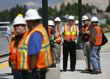 Francisco Kjolseth  |  The Salt Lake Tribune Lehi Mayor Bert Wilson, third from right, joins other officials, work crews and media for a glimpse of the first FrontRunner train arriving in Utah County at the Lehi Station on Monday, June 11, 2012, marking the beginning of the testing process of the new commuter rail line that links Provo to Salt Lake City.