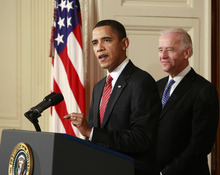 President Barack Obama, joined by Vice President Joe Biden, makes a statement to the nation Sunday night following the final vote in the House of Representatives for a comprehensive overhaul of the health care system, in the East Room of the White House in Washington, March 21, 2010.  (AP Photo/J. Scott Applewhite)