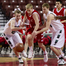 Trent Nelson  |  The Salt Lake Tribune East's Parker Van Dyke dribbles out of a double team before being fouled. East vs. Olympus, 4A High School Basketball Championships Wednesday, February 29, 2012 at the Maverik Center in West Valley City, Utah. Olympus' Stuart Pace, left, and Will Canon defending.