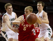 Trent Nelson  |  The Salt Lake Tribune East's Parker Van Dyke is defended by Olympus' Will Cannon, left, and Coulson Hardy during the 4A High School Basketball Championships on Wednesday, Feb. 29, 2012, at the Maverik Center in West Valley City.