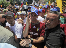 Surrounded by supporters, opposition presidential candidate Henrique Capriles, center, gestures during a march before registering his candidacy for the presidency  in Caracas, Venezuela, Sunday, June 10, 2012. (AP Photo/Fernando Llano)